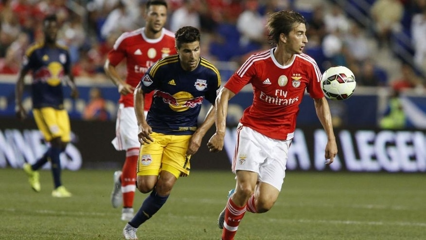 Benfica's Filip Djuricic (R) fights for the ball during the International Champions Cup football match between SL Benfica and Red Bulls at the Red Bull Arena on July 26, 2015 in Harrison, New Jersey. AFP PHOTO/KENA BETANCUR (Photo credit should read KENA BETANCUR/AFP/Getty Images)