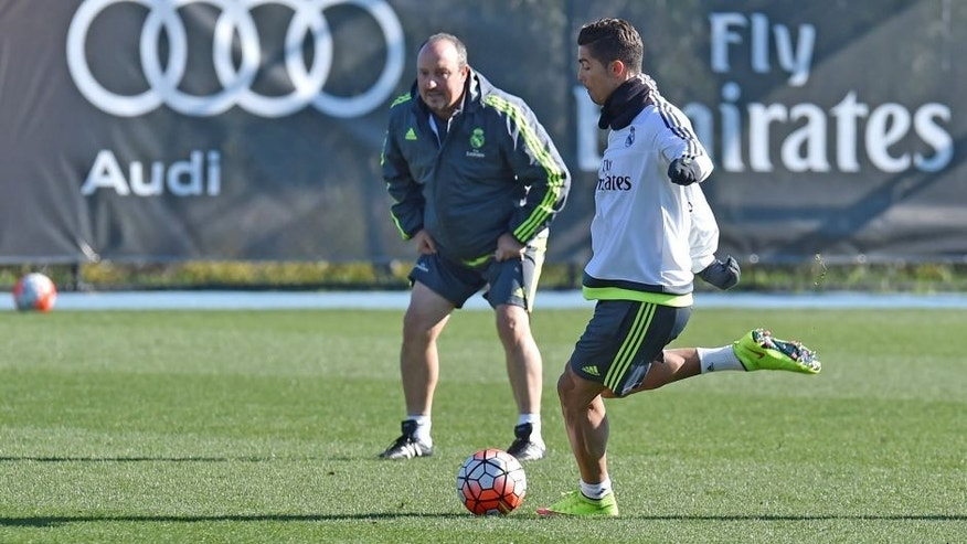 Real Madrid's coach Rafa Benitez (L) watches forward Cristiano Ronaldo (R) during a team training session during the International Champions Cup tournament in Melbourne on July 20, 2015. AFP PHOTO / Paul CROCK -- IMAGE RESTRICTED TO EDITORIAL USE - STRICTLY NO COMMERCIAL USE (Photo credit should read PAUL CROCK/AFP/Getty Images)