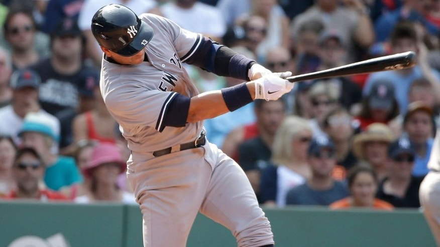 New York Yankees' Alex Rodriguez lines into a double play on a pitch by Boston Red Sox's Alexi Ogando in the seventh inning of a baseball game at Fenway Park, Sunday, July 12, 2015, in Boston. The Yankees won 8-6. (AP Photo/Steven Senne)