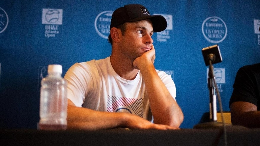 Andy Roddick listens to a question during a press conference at the Atlanta Open tennis tournament Monday, July 27, 2015, in Atlanta. Roddick is coming out of retirement to play doubles with friend Mardy Fish in the Atlanta Open. (AP Photo/David Goldman)