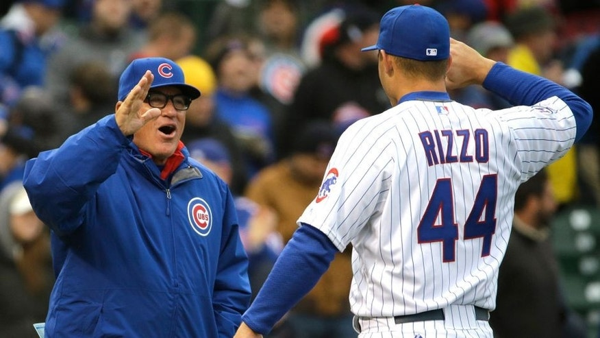 Chicago Cubs manager Joe Maddon, left, celebrates with Anthony Rizzo after the Cubs defeated the St. Louis Cardinals 2-0 in a baseball game in Chicago, Wednesday, April 8, 2015. (AP Photo/Nam Y. Huh)