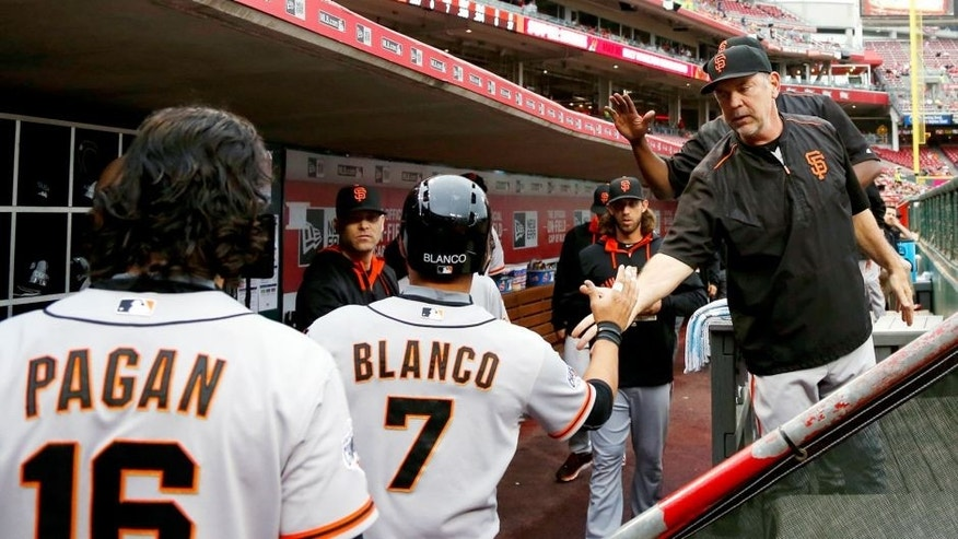 CINCINNATI, OH - MAY 14: Gregor Blanco #7 of the San Francisco Giants is congratulated by manager Bruce Bochy after scoring a run in the first inning of the game against the Cincinnati Reds at Great American Ball Park on May 14, 2015 in Cincinnati, Ohio. (Photo by Joe Robbins/Getty Images)
