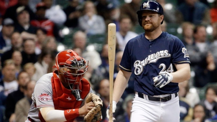 <p>Milwaukee Brewers' Adam Lind flips his bat in front of Cincinnati Reds catcher Brayan Pena after striking out during the fourth inning of a baseball game Wednesday, April 22, 2015, in Milwaukee. (AP Photo/Morry Gash)</p>