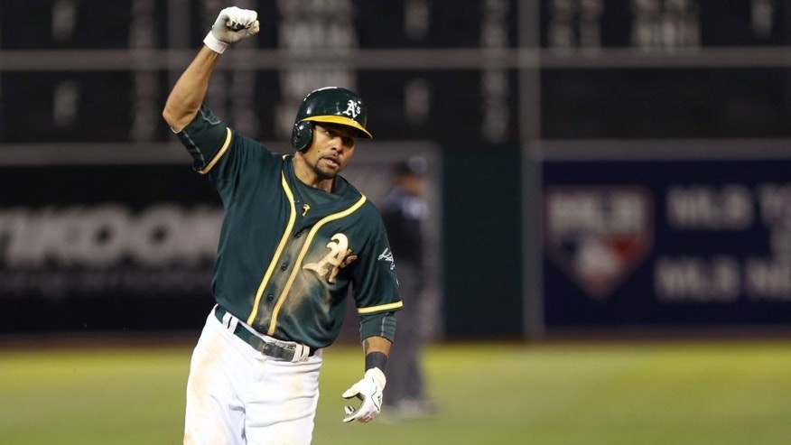 Apr 3, 2014; Oakland, CA, USA; Oakland Athletics center fielder Coco Crisp (4) celebrates as he rounds the bases on a walk off home run against the Seattle Mariners during the twelfth inning at O.co Coliseum. The Oakland Athletics defeated the Seattle Mariners 3-2. Mandatory Credit: Kelley L Cox-USA TODAY Sports
