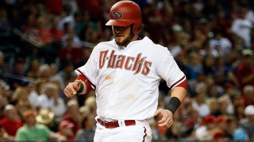 Arizona Diamondbacks catcher Jarrod Saltalamacchia scores on a sacrifice fly by Ender Iciarte during the fifth inning of a baseball game against the Atlanta Braves, Monday, June 1, 2015, in Phoenix. (AP Photo/Matt York)