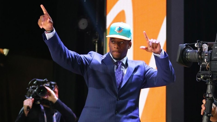 Apr 30, 2015; Chicago, IL, USA; DeVante Parker (Louisville) is selected as the number 14th overall pick to the Miami Dolphins in the first round of the 2015 NFL Draft at the Auditorium Theatre of Roosevelt University. Mandatory Credit: Dennis Wierzbicki-USA TODAY Sports