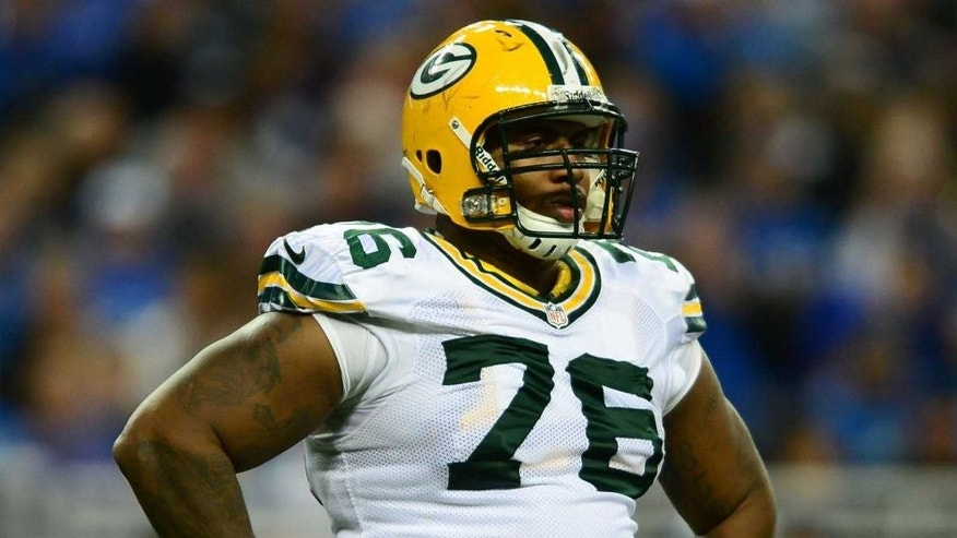 Nov 28, 2013; Detroit, MI, USA; Green Bay Packers defensive end Mike Daniels (76) against the Detroit Lions at Ford Field.