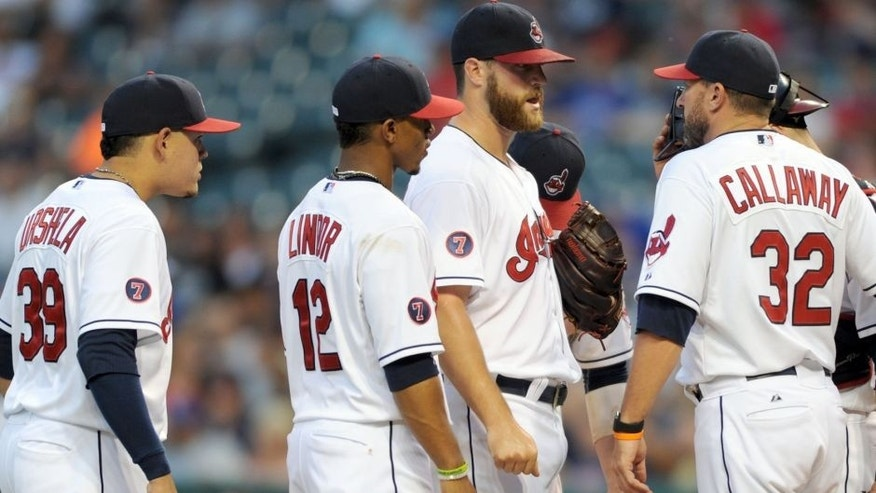 Jul 27, 2015; Cleveland, OH, USA; Cleveland Indians starting pitcher Cody Anderson (56) talks with Cleveland Indians pitching coach Mickey Callaway (32) during the fifth inning against the Kansas City Royals at Progressive Field.