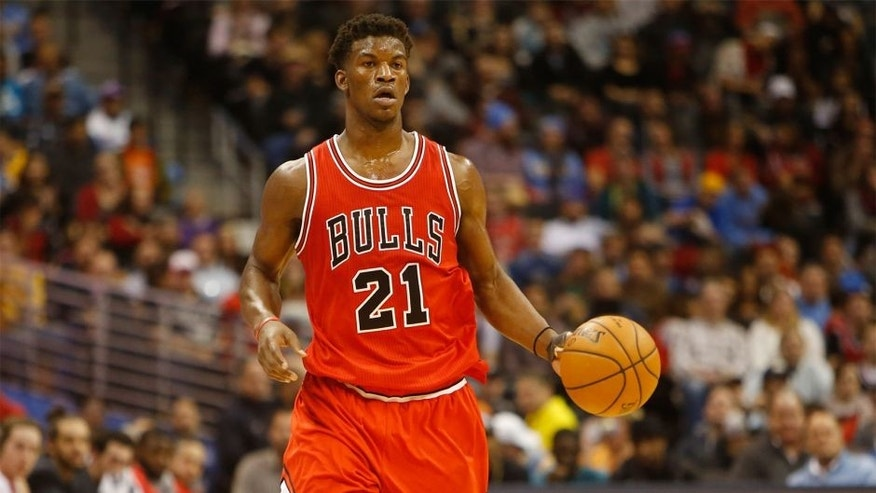 Nov 25, 2014; Denver, CO, USA; Chicago Bulls guard Jimmy Butler (21) during the game against the Denver Nuggets at Pepsi Center. Mandatory Credit: Chris Humphreys-USA TODAY Sports