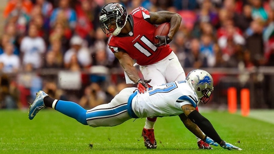 LONDON, ENGLAND - OCTOBER 26: Julio Jones #11 of the Atlanta Falcons evades the tackle from Glover Quin #27 of the Detroit Lions during the NFL match between Detroit Lions and Atlanta Falcons at Wembley Stadium on October 26, 2014 in London, England. (Photo by Mike Hewitt/Getty Images)
