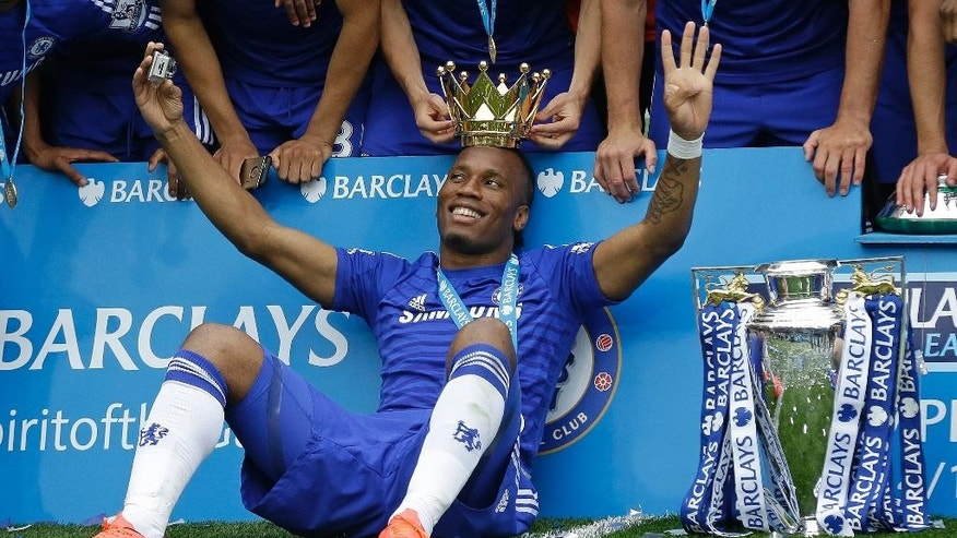 FILE - In this Sunday, May 24, 2015 file photo, the crown of the trophy is placed on the head of Didier Drogba after the English Premier League soccer match between Chelsea and Sunderland at Stamford Bridge stadium in London. Montreal Impact says it has signed former Chelsea striker Didier Drogba. Impact confirmed the signing on Monday, July 27, 2015 following a trade with Chicago Fire, which had initially completed a move for the 37-year-old forward. (AP Photo/Matt Dunham, File)