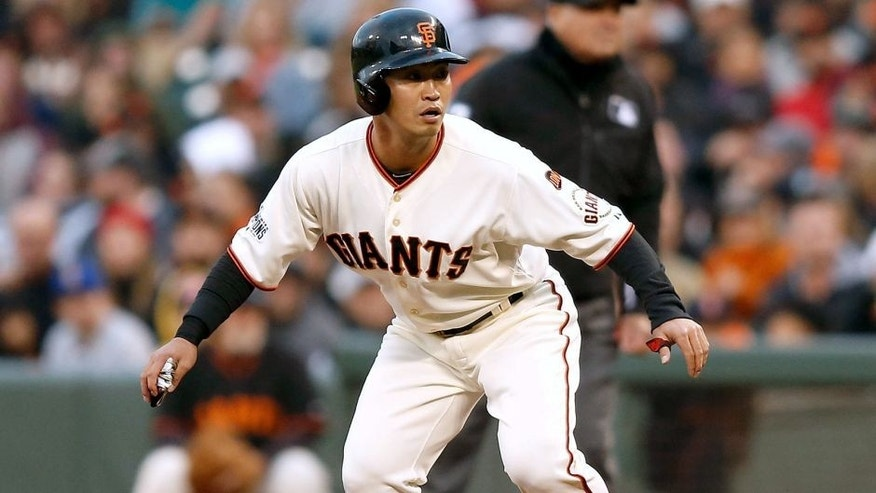 SAN FRANCISCO, CA - JUNE 15: Base runner Nori Aoki #23 of the San Francisco Giants watches play from first base in the second inning against the Seattle Mariners at AT&T Park on June 15, 2015 in San Francisco, California. (Photo by Lachlan Cunningham/Getty Images)