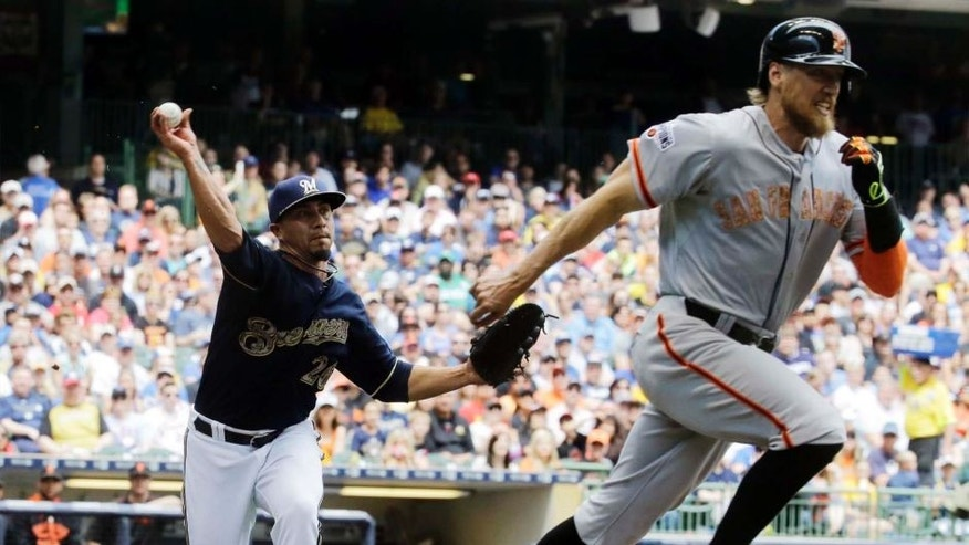 Monday, May 25: Milwaukee Brewers starting pitcher Kyle Lohse throws out the San Francisco Giants' Hunter Pence during the third inning in Milwaukee. The Brewers lost 8-4.