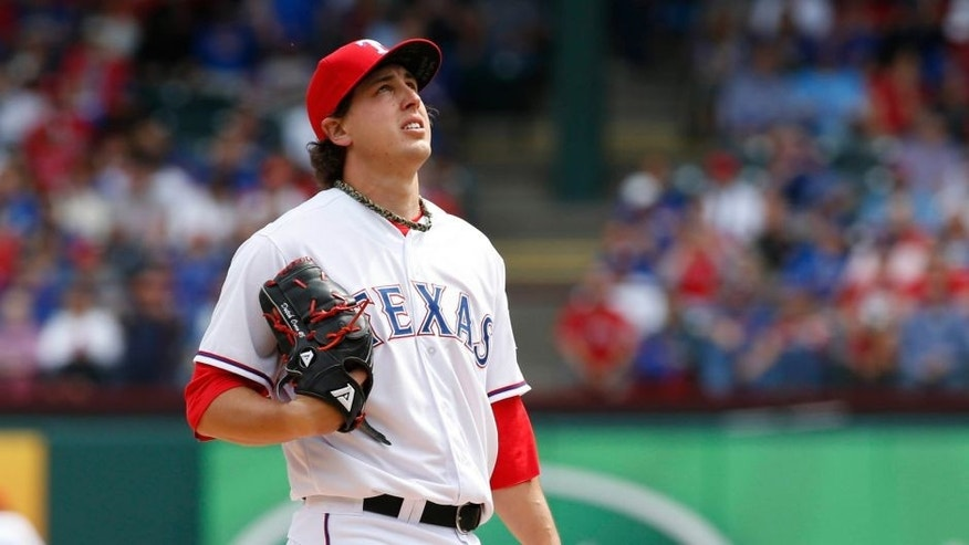 Apr 10, 2015; Arlington, TX, USA; Texas Rangers starting pitcher Derek Holland (45) prepares to pitch in the game against the Houston Astros at Globe Life Park in Arlington. Mandatory Credit: Tim Heitman-USA TODAY Sports