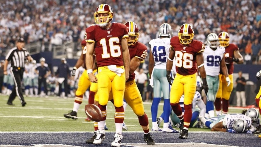 Oct 27, 2014; Arlington, TX, USA; Washington Redskins quarterback Colt McCoy (16) celebrates scoring a touchdown in the fourth quarter against the Dallas Cowboys at AT&T Stadium. Mandatory Credit: Tim Heitman-USA TODAY Sports