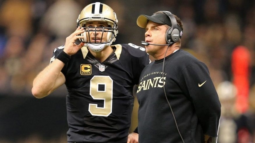 Nov 24, 2014; New Orleans, LA, USA; New Orleans Saints quarterback Drew Brees (9) talks to head coach Sean Payton in the first quarter of their game against the Baltimore Ravens at the Mercedes-Benz Superdome. Mandatory Credit: Chuck Cook-USA TODAY Sports