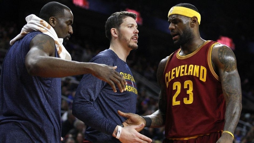 <p>Feb 24, 2015; Auburn Hills, MI, USA; Cleveland Cavaliers forward LeBron James (23) gets greeted by guard Mike Miller (18) and center Kendrick Perkins (3) as he goes to the bench during the second quarter against the Detroit Pistons at The Palace of Auburn Hills.</p>