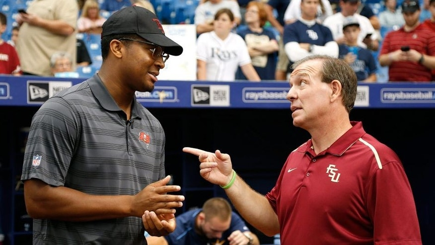ST. PETERSBURG, FL - JULY 26: Quarterback Jameis Winston of the Tampa Bay Buccaneers (L) speaks with his former coach, head football coach Jimbo Fisher of Florida State University just outside of the Tampa Bay Rays' dugout before the start of an MLB game between the Tampa Bay Rays and the Baltimore Orioles on July 26, 2015 at Tropicana Field in St. Petersburg, Florida. (Photo by Brian Blanco/Getty Images)