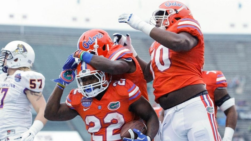 Jan 3, 2015; Birmingham, AL, USA; Florida Gators running back Adam Lane (22) celebrates with teammates after scoring a touchdown against East Carolina Pirates during the Birmingham Bowl at Legion Field. Mandatory Credit: Marvin Gentry-USA TODAY Sports