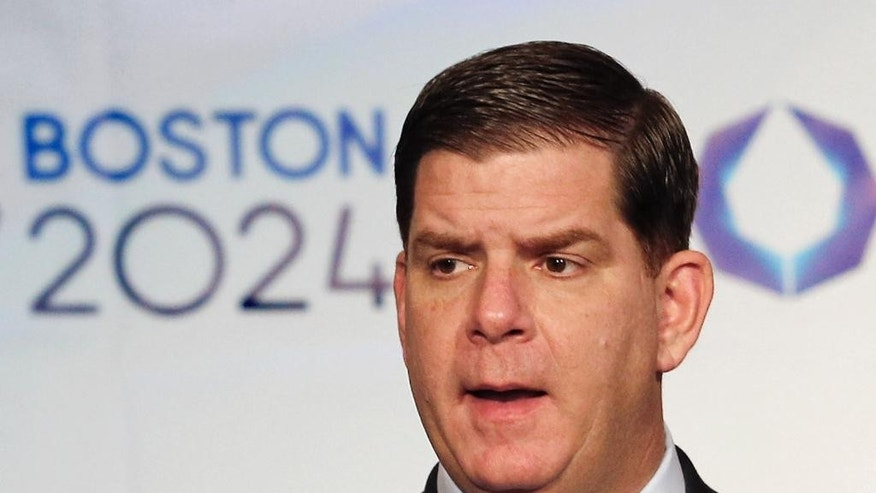 FILE - In this Jan. 9, 2015, file photo, Boston Mayor Martin Walsh speaks during a news conference in Boston after the city was picked by the USOC as its bid city for the 2024 Olympic Summer Games. Walsh said Monday, July 27, 2015, he won't sign a host city contract, which is key to the city's bid, without more assurances that taxpayers won't foot the bill. (AP Photo/Winslow Townson, File)