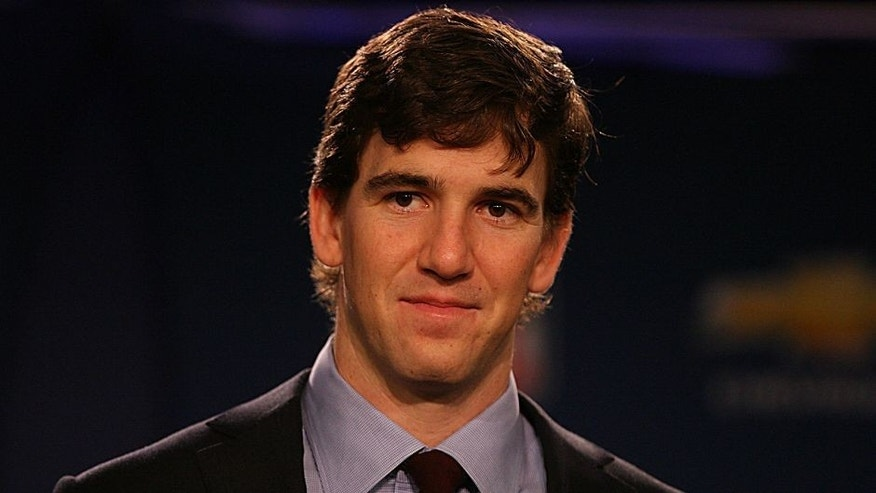 Feb 6, 2012; Indianapolis, IN, USA; New York Giants quarterback Eli Manning during the Super Bowl most valuable player and winning head coach press conference at the Super Bowl XLVI media center at the J.W. Marriott. Mandatory Credit: Brian Spurlock-USA TODAY Sports