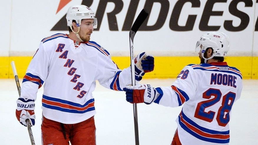Jun 7, 2014; Los Angeles, CA, USA; New York Rangers defenseman Ryan McDonagh (27) celebrates with center Dominic Moore (28) after scoring a goal against the Los Angeles Kings in the first period during game two of the 2014 Stanley Cup Final at Staples Center. Mandatory Credit: Richard Mackson-USA TODAY Sports