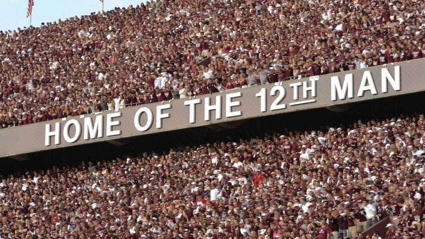 Sep 14, 2013; College Station, TX, USA; Texas A&M Aggies fans sing the Aggie War Hymn against the Alabama Crimson Tide during the second half at Kyle Field. Alabama won 49-42. Mandatory Credit: Thomas Campbell-USA TODAY Sports