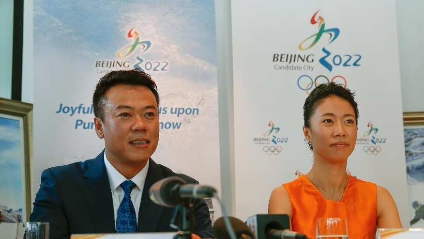 China's Olympic gold medalist figure skating pair, Shen Xue, right, and Zhao Hongbo, speak to the media during a press conference in Kuala Lumpur, Malaysia,Tuesday, July, 28, 2015. Malaysia is hosting the 128th International Olympic Committee executive board meeting where the vote for the host cities of the 2022 Olympic Winter Games and for the 2020 Youth Olympic Winter Games will take place. (AP Photo/Vincent Thian)