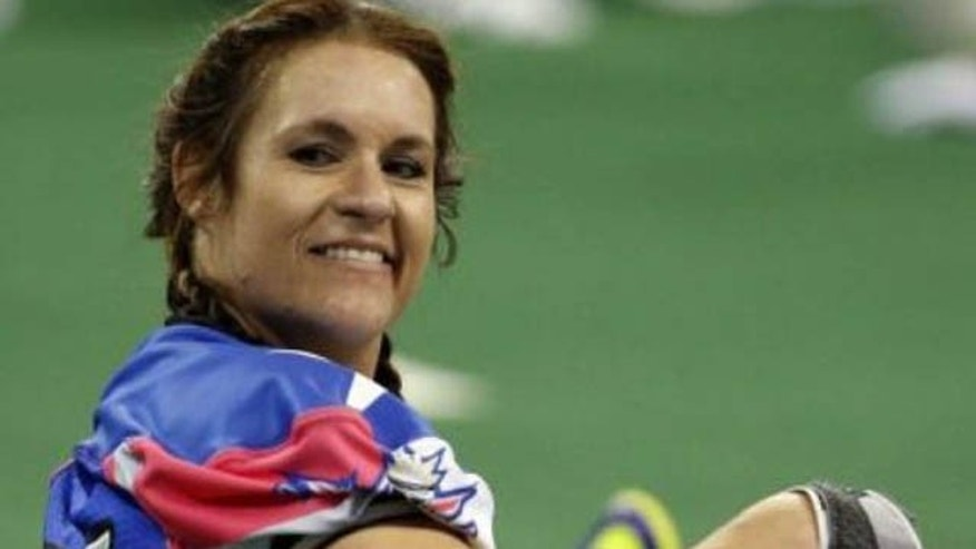 Feb. 15, 2014: Texas Revolution player Jennifer Welter warms up for the Revolution's Indoor Football League game against the North Texas Crunch in Allen, Texas. Welter became what is believed to be the first woman who wasn't a kicker or holder to play in a men's pro football game. (AP)
