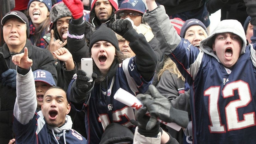 BOSTON - FEBRUARY 4: Patriots fans cheer as the Super Bowl victory parade made its way up Boylston Street in Boston on February 4, 2015. (Photo by Wendy Maeda/The Boston Globe via Getty Images)