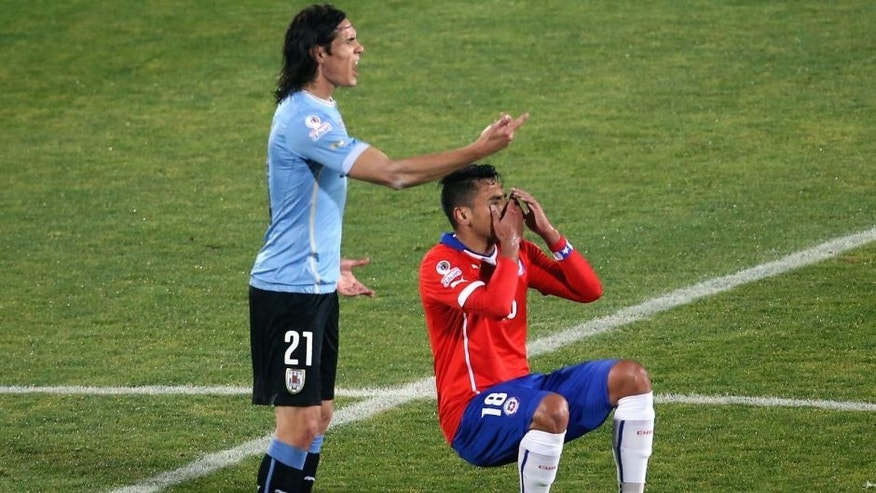 Uruguay's forward Edinson Cavani (L) and Chile's defender Gonzalo Jara gesture during their 2015 Copa America football championship quarterfinal match, in Santiago, on June 24, 2015. AFP PHOTO / CLAUDIO REYES (Photo credit should read Claudio Reyes,Claudio Reyes/AFP/Getty Images)