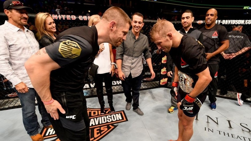 CHICAGO, IL - JULY 25: TJ Dillashaw (R) is congratulated by coach Duane Ludwig after his TKO victory over Renan Barao of Brazil in their UFC bantamweight championship bout during the UFC event at the United Center on July 25, 2015 in Chicago, Illinois. (Photo by Jeff Bottari/Zuffa LLC/Zuffa LLC via Getty Images)
