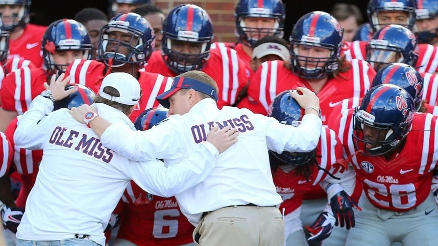 Nov 29, 2014; Oxford, MS, USA; Mississippi Rebels head coach Hugh Freeze before taking the field in the game between the Mississippi Rebels and the Mississippi State Bulldogs at Vaught-Hemingway Stadium. Mandatory Credit: Spruce Derden-USA TODAY Sports