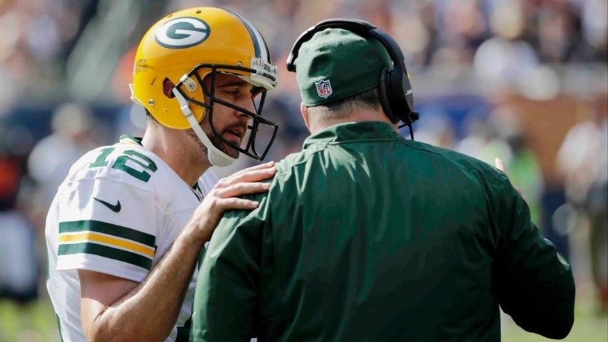Green Bay Packers quarterback Aaron Rodgers (left) talks to head coach Mike McCarthy on the sideline in the second half.