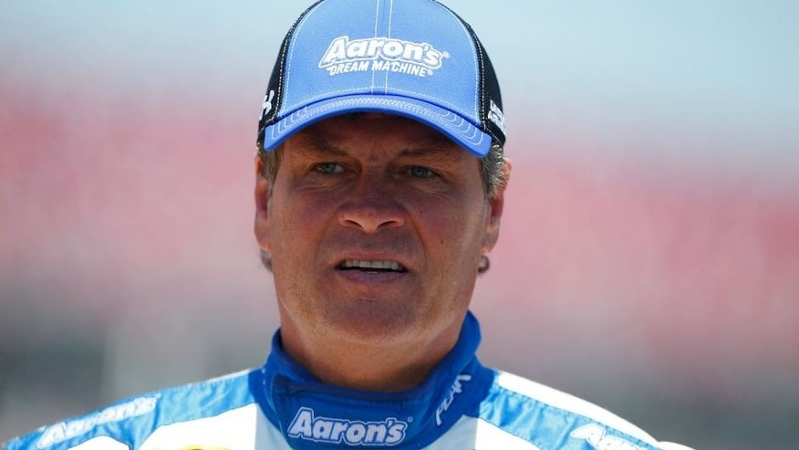 TALLADEGA, AL - MAY 02: Michael Waltrip, driver of the #55 Aaron's Dream Machine Toyota, stands on the grid during qualifying for the NASCAR Sprint Cup Series GEICO 500 at Talladega Superspeedway on May 2, 2015 in Talladega, Alabama. (Photo by Matt Sullivan/Getty Images)