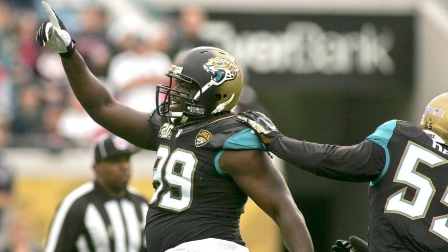 Dec 7, 2014; Jacksonville, FL, USA; Jacksonville Jaguars defensive tackle Sen'Derrick Marks (99) celebrates after a sack in the first quarter of their game against the Houston Texans at EverBank Field. Mandatory Credit: Phil Sears-USA TODAY Sports