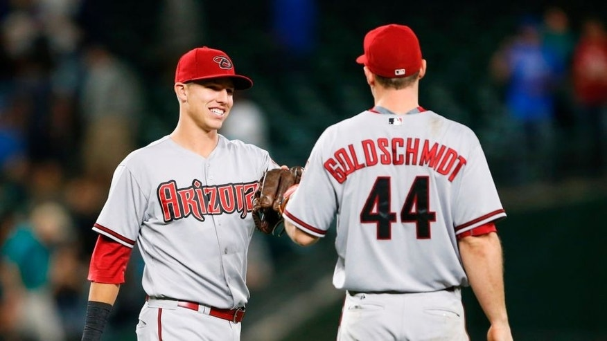 Jul 27, 2015; Seattle, WA, USA; Arizona Diamondbacks first baseman Paul Goldschmidt (44) and third baseman Jake Lamb (19) bump gloves following the final out of a 4-3, 10-inning victory against the Seattle Mariners at Safeco Field. Mandatory Credit: Joe Nicholson-USA TODAY Sports