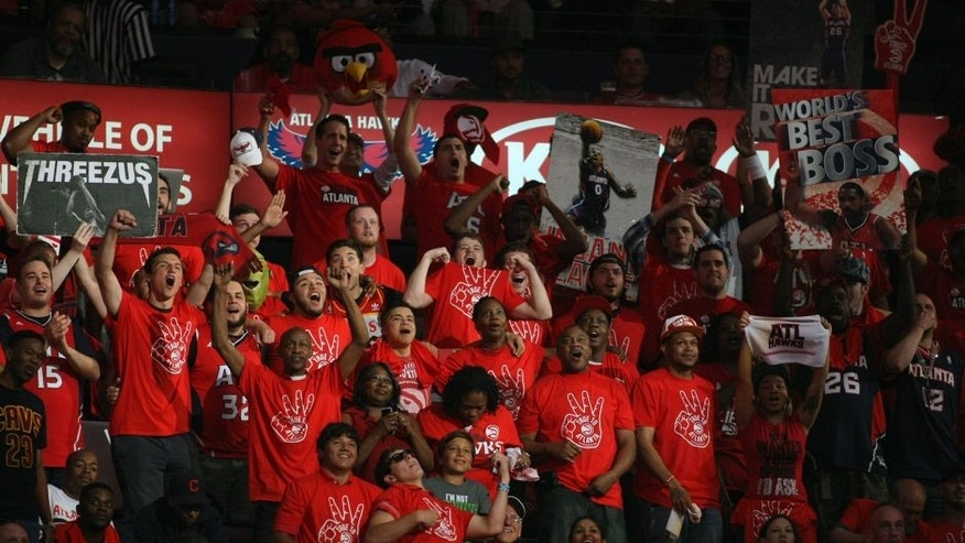 May 22, 2015; Atlanta, GA, USA; Atlanta Hawks fans cheer during the second quarter in game two of the Eastern Conference Finals of the NBA Playoffs against the Cleveland Cavaliers at Philips Arena. Mandatory Credit: Brett Davis-USA TODAY Sports