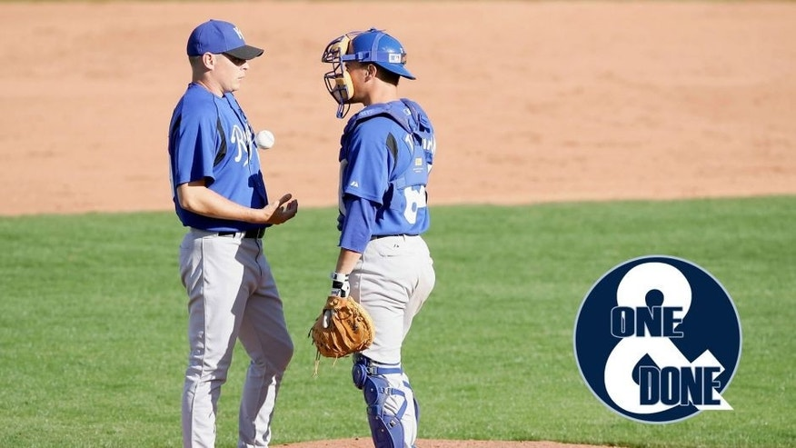SURPRISE, AZ - MARCH 2: Brian Bass #59 of the Kansas City Royals talks with catcher Matt Tupman #64 before pitching against the Texas Rangers during a Spring Training game on March 2, 2006 at Surprise Stadium in Surprise, Arizona. The game ended in a 5-5 tie. (Photo by Lisa Blumenfeld/Getty Images)
