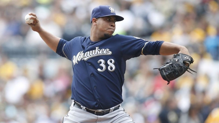 Sep 21, 2014; Pittsburgh, PA, USA; Milwaukee Brewers starting pitcher Wily Peralta delivers a pitch against the Pittsburgh Pirates during the first inning at PNC Park.