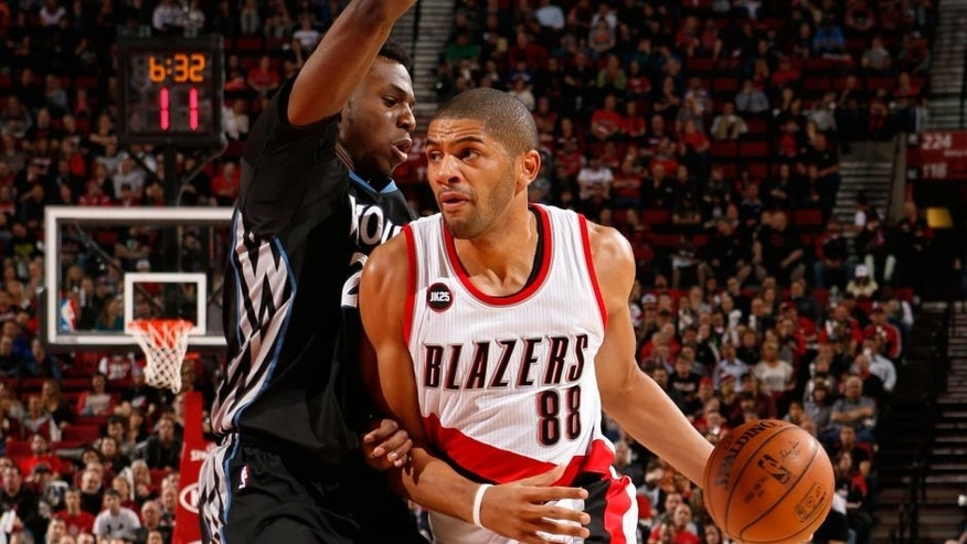 <p>PORTLAND, OR - APRIL 8: Nicolas Batum #88 of the Portland Trail Blazers handles the ball against the Minnesota Timberwolves on April 8, 2015 at the Moda Center Arena in Portland, Oregon. NOTE TO USER: User expressly acknowledges and agrees that, by downloading and or using this photograph, user is consenting to the terms and conditions of the Getty Images License Agreement. Mandatory Copyright Notice: Copyright 2015 NBAE (Photo by Cameron Browne/NBAE via Getty Images)</p>