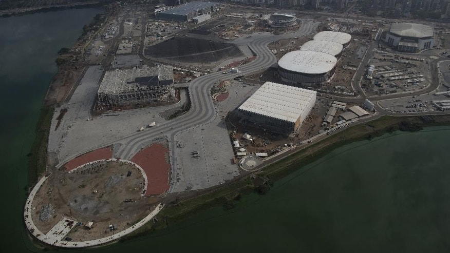 The Olympic Park which will host Rio's 2016 Olympics is seen under construction in Rio de Janeiro, Brazil, Monday, July 27, 2015. The Olympics will offer 28 sports, 300 events, 10,500 athletes and, with the exception of five football venues, it's all packed into Rio for 17 days. The Paralympics add two more weeks, and thousands more athletes. (AP Photo/Leo Correa)