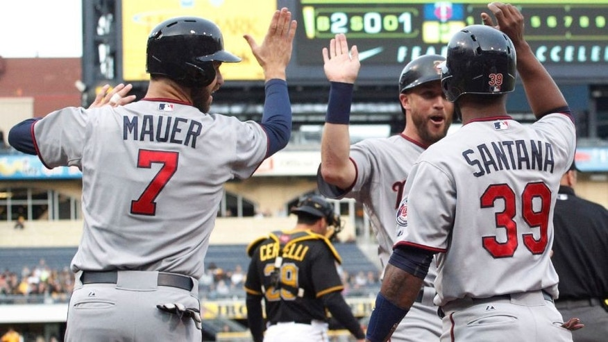 <p>May 20, 2015; Pittsburgh, PA, USA; Minnesota Twins first baseman Joe Mauer (7) and third baseman Trevor Plouffe (middle) and shortstop Danny Santana (39) celebrate after all three players scored against the Pittsburgh Pirates during the first inning of an inter-league game at PNC Park. Mandatory Credit: Charles LeClaire-USA TODAY Sports</p>