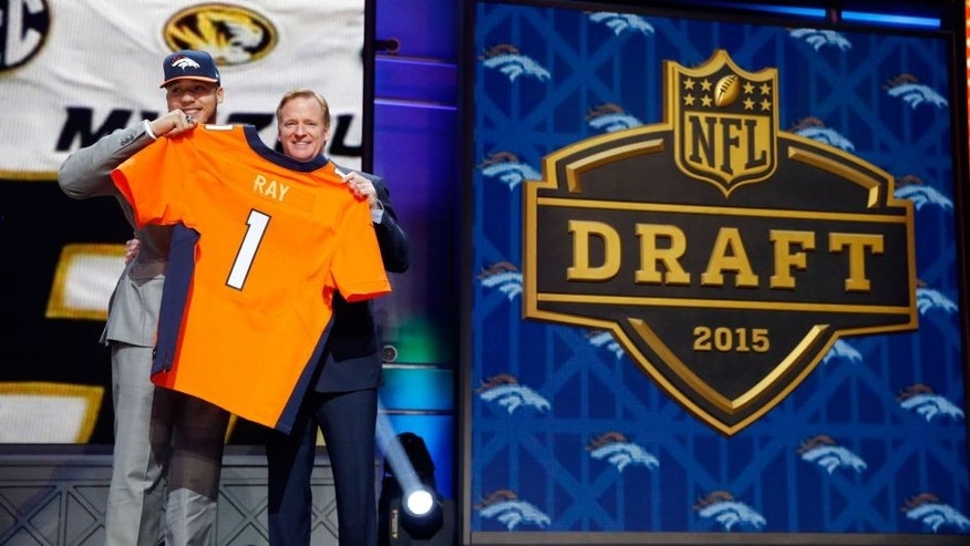 Missouri defensive lineman Shane Ray poses for photos with NFL commissioner Roger Goodell after being selected by the Denver Broncos as the 23rd pick in the first round of the 2015 NFL Draft, Thursday, April 30, 2015, in Chicago. (AP Photo/Charles Rex Arbogast)