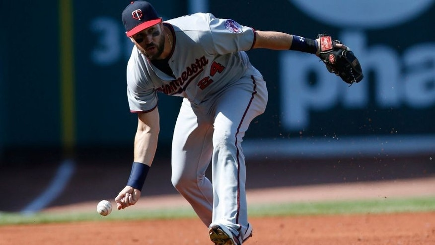 <p>Jun 4, 2015; Boston, MA, USA; Minnesota Twins third baseman Trevor Plouffe (24) fails to grab a ground ball during the first inning against the Boston Red Sox at Fenway Park. Mandatory Credit: Greg M. Cooper-USA TODAY Sports</p>