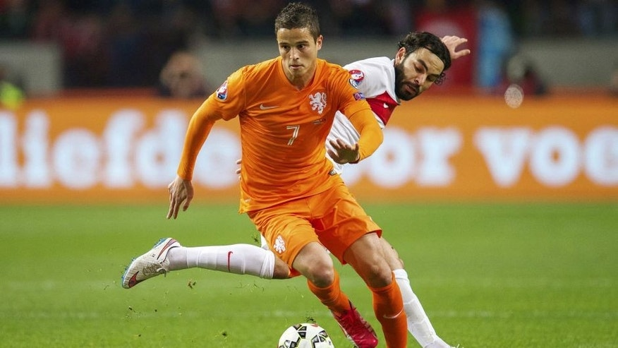 (L-R) Ibrahim Afellay of Holland, Selcuk Inan of Turkye during the UEFA Euro 2016 qualifying match between Netherlands and Turkey on March 28, 2015 at the Amsterdam Arena at Amsterdam, The Netherlands.(Photo by VI Images via Getty Images)