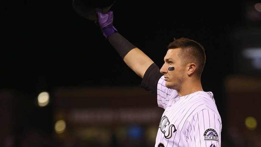 "<p style=""font-family: tahoma, arial, helvetica, sans-serif; font-size: 11.9999990463257px;"">DENVER, CO - MAY 03: Troy Tulowitzki #2 of the Colorado Rockies acknowledges the fans after hitting his 1000th career hit, a single off of relief pitcher Daisuke Matsuzaka #16 of the New York Mets in the seventh inning at Coors Field on May 3, 2014 in Denver, Colorado. (Photo by Doug Pensinger/Getty Images)</p>"