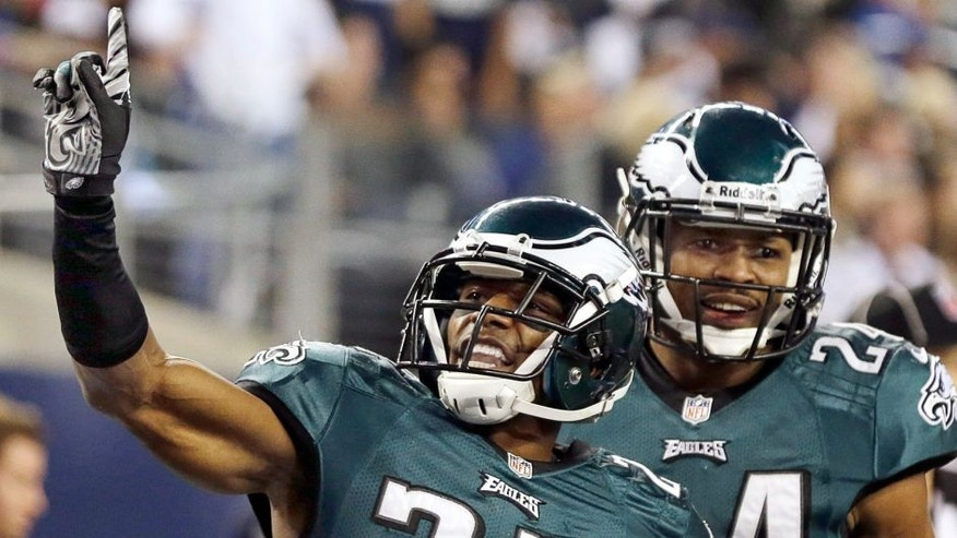 After defending against a touchdown pass to Dallas Cowboys wide receiver Dez Bryant, Philadelphia Eagles cornerback Brandon Boykin (22) celebrates with cornerback Bradley Fletcher (24) during the second half of an NFL football game, Sunday, Dec. 29, 2013, in Arlington, Texas. (AP Photo/Tim Sharp)