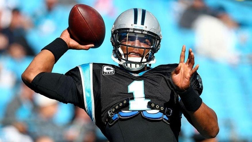 CHARLOTTE, NC - DECEMBER 01: Cam Newton #1 of the Carolina Panthers warms up before their game against the Tampa Bay Buccaneers at Bank of America Stadium on December 1, 2013 in Charlotte, North Carolina. (Photo by Streeter Lecka/Getty Images)
