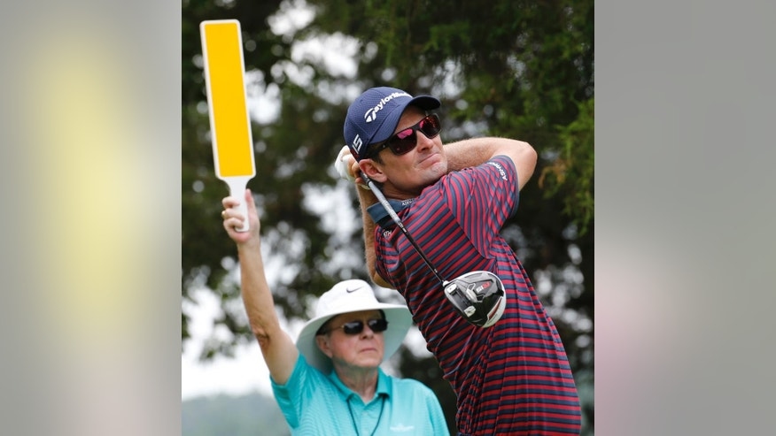 Justin Rose, of England, watches his tee shot on the second hole during the pro-am for the Quicken Loans National Golf tournament at the Robert Trent Jones Golf Club in Gainesville, Va., Wednesday, July 29, 2015.  (AP Photo/Steve Helber)